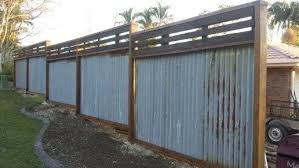 Rusted corrugated metal fence Rock Filled Recycled Hardwood Timber Fence Rusty Corrugated Iron Timber Joist And Bearers Salvaged From House Demolition Planed Sanded Oiled Pinterest Recycled Hardwood Timber Fence Rusty Corrugated Iron Timber Joist
