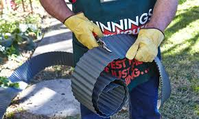 person cutting the corrugated edging