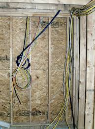 it s electric wiring continues whole house renovation wires running to electrical panels in the basement left and garage right will be covered drywall this week see the wad of blue and white wires in