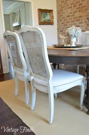woven wingback chairs for the head chairs of our dining room table i love the height and casual feel of these chairs mixed with the white cane backs