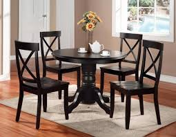 furniture black wooden round dining table set with carved pedestal base added by four chairs