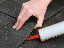 roof repair place:  man replacing a leaking roof shingle