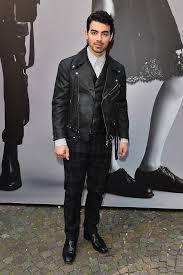 joe jonas wears a sel black gold biker jacket with trousers