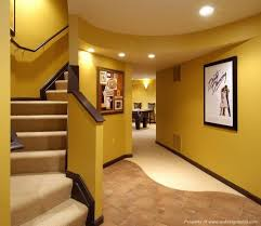 interior astounding yellow finished basement ideas with decorative wall art picture frames including nice recessed