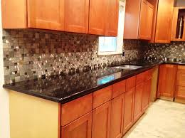 Black Granite Countertops With Tile Backsplash Stunning Medium Oak Cabinets With Granite Countertops Image Cabinets And