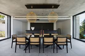 modern mansion dining room. In This Modern House, The Matte Black Bulthaup Kitchen Has Been Paired With A Dark Mansion Dining Room