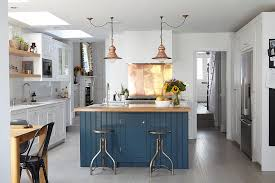 view in gallery modern industrial kitchen with a shiny copper backsplash design blakes london