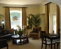 sliding glass doors living room with brown curtains