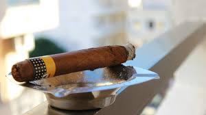 how to get rid of cigar smoke cigar in ashtray with ash by window