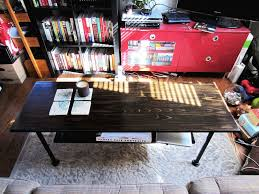 picture of industrial style 2 tier coffee table w iron piping