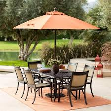 outdoor dining set and sunbrella umbrella with outdoor rug also patio pavers