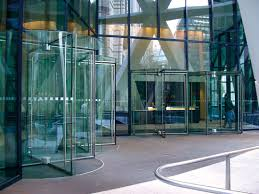 all glass revolving doors are well suited for a glass facade