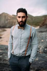 dark grey tweed pants a light grey shirt a brown printed bow tie and