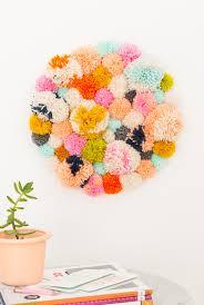 diy pom pom wall hanging by top lifestyle blogger ashley rose sugar cloth