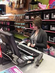 tory sherman works the cash register at plato s closet at 5643 centennial center blvd