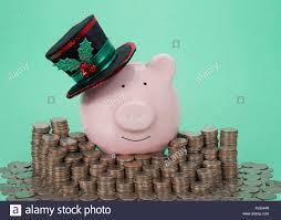 pink piggy bank wearing a holiday decorated top hat smiling facing viewer surrounded by stacks of coins green background