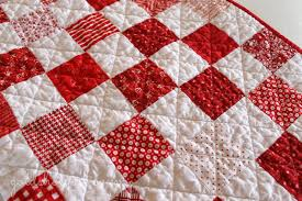 Gold Shoe Girl: Red & White Patchwork Quilt & I really really liked the scale of this print and I can see using it in  different colors on lots of quilts. Something about polka dots that ties  together ... Adamdwight.com