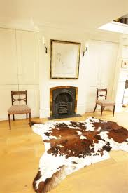 Entrancing Home Interior Decoration With Cowhide Rug : Interactive Dining  Room Decoration Using Double White Drum