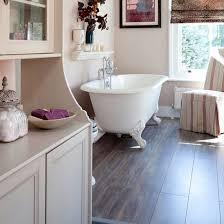 bathroom floor laminate. Traditional Bathroom With Dark Laminate Flooring And Rolltop Bath Floor E