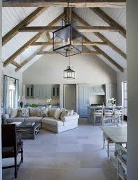 rafters living lighting. Cathedral Ceilings With Exposed Beams. White Washed, Bright Interior. Stone Floor. Rafters Living Lighting E