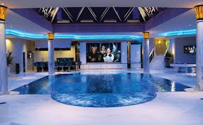 indoor infinity pool. Indoor Infinity Pool With Movie Theater And Bar.. Oh Yeah, The Louvre Pyramid On Top. S