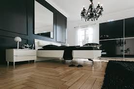 luxurious brushed bronze venetian bedroom chandelier over white master paltform mattress bed on wooden floors as decorate in european modern master bedroom