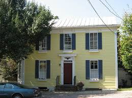 yellow house red door. yellow house, blue shutters, red door | exterior house colors o