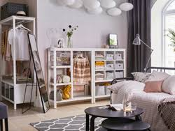 white and pink bedroom with light HEMNES open storage and a black bed and  mirror