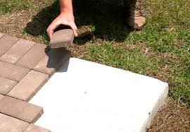 how to properly install 1 pavers over concrete