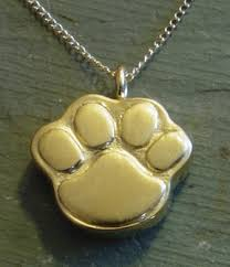 gold plated paws pet cremation pendant
