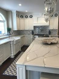 beautiful kitchen with quartz countertops in a pattern similar to calacatta marble