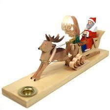 carved santa in deer drawn sleigh candleholder