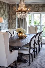black salvaged wood dining table restoration hardware salvaged wood wingback dining room chairs