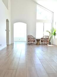 i m intrigued by this porcelain plank wood tiles links in for tile flooring ideas living room