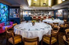 private dining room the ivy soho brasserie round table set up photos