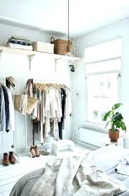 bedroom without a closet clothes storage