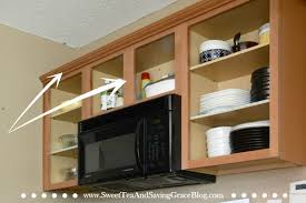 you can drastically update your existing kitchen cabinets on a budget with just a few