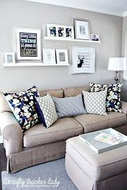 what to put on wall shelves best shelves above couch ideas on condo decorating and what to put on wall shelves