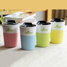 Elegant 4 Color Reusable Travel Cup To Go Coffee Cup Pla Mug With Lid And Silicone  Sleeve