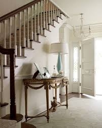 front door tableentryway foyer hallway entry house home console table rug stairs