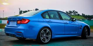 black bmw m3 2014. elsewhere a black unpainted cfrp roof is standard fitment on the car and at back m3 sedan gets gurney spoiler lip m4 coupe bmw 2014