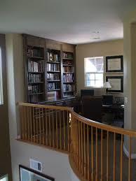 loft home office. built in desk and bookshelves home office loft