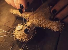sorceress pierces a voodoo doll