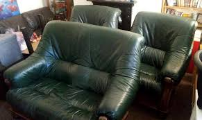 comfortable set green leather sofa armchair with mahogany wood trim