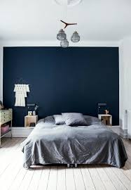 Nordic Bedroom Nordic Bedroom With A Dark Blue Colored End Wall And Grey Pillows