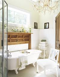 bathroom lighting designs with luxury chandelier above white freestanding bathtub and white wooden chair also small sqaure table plus simple wooden shelf