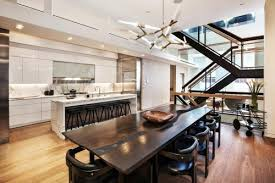 this generous tribeca triplex bines the most desirable elements of loft and townhouse living in a distinctly modern retreat