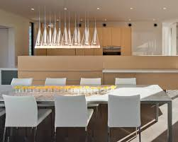 modern dining room modern look lights long table narrow ledge flowers onthe table dining lights chandelier