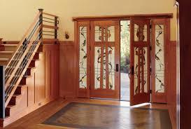 entryway with custom glass front door