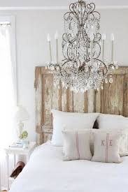 Attractive Romantic Bedroom With Chic Chandelier And Weathered Rustic Headboard